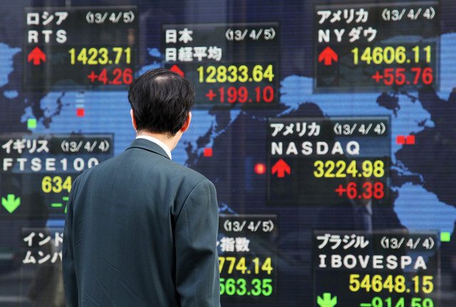 تباين الأسهم الاسيوية مع انتظار المستثمرين لقرار الفائدة الفيدرالي